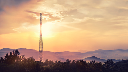 Beautiful sunset over the hills with a cell tower