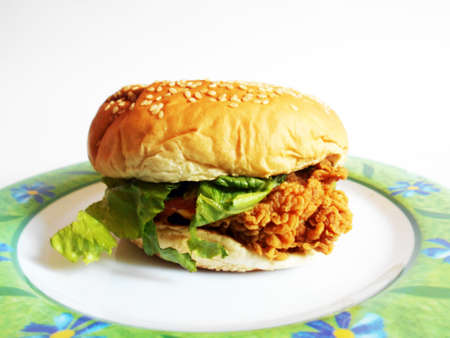 Zinger chicken sandwich (burger) in front of white background photo