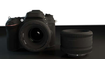 Camera with lens isolated in dark area Stock Photo
