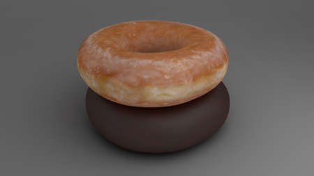 glazed donut stacked over a chocolate donut Stock Photo