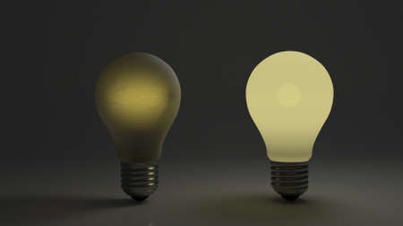 Dim and bright bulb side by side showing comparison of dim and bright ideas. Stock Photo