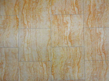 Brown and white wood marble patterned and textured tiles arranged. It has a very cloudy dispersment of colors. This could be used in bathrooms, kitchens etc.