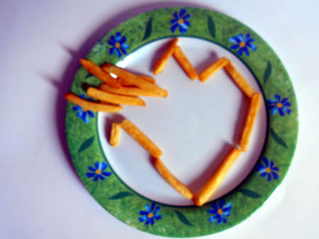 Fries in the shape of a busted heart Stock Photo