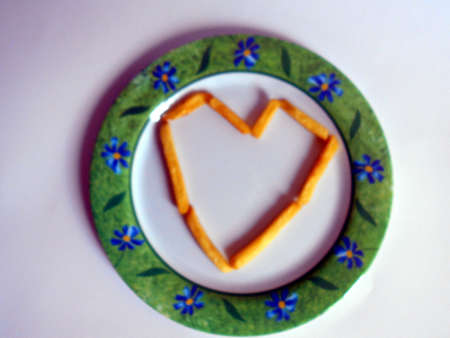 Heart shaped fries on a white plate