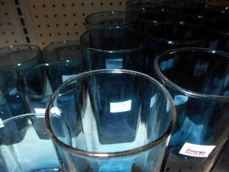 Blue glass  cups sitting on a shelf