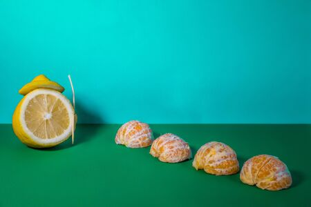 Lemon and mandarin on a blue background