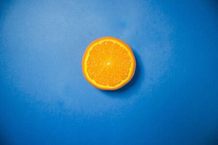 Mandarin on a blue background 스톡 콘텐츠