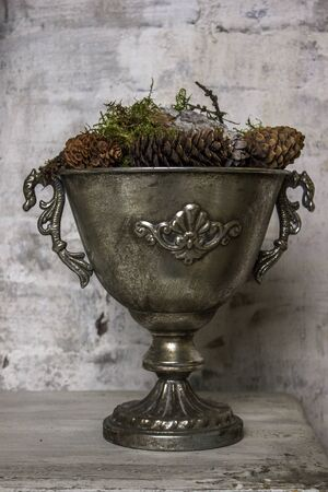 Old pewter bowl, cup on the wooden table