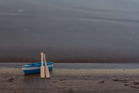 blue wooden boat stands on the shore with oars Banque d'images