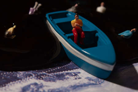 ecology theme, water pollution, a man in a boat