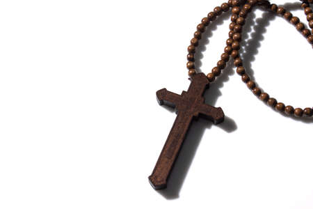 Wooden christian cross necklace isolation on white background with free space