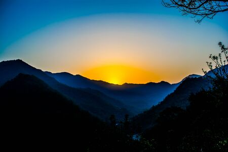 Sunrise behind the mountains of Rishikesh, Located in the foothills of the Himalayas in northern India,
