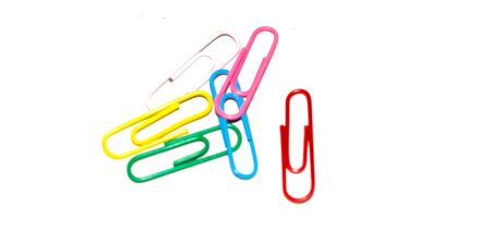 Push pins and paper clips in different colors isolated on white background.