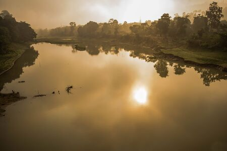 Landscape of mountains, tree and fog in the Sunrise time at Kaziranga national park, Assam, India.