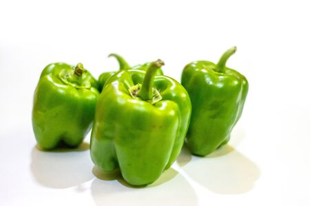Fresh green capsicum or bell pepper isolated on a white background Zdjęcie Seryjne