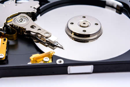 Internal parts of a hard disk isolated on a white background. Close up of Hard disk drive inside view.