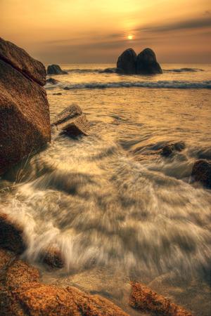 Sunrise with wave splash seashore photo
