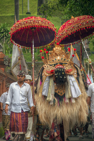Bali, Indonesia 10 Dec 2011 - Barong and Villager in a procession at Tampak Siring Temple