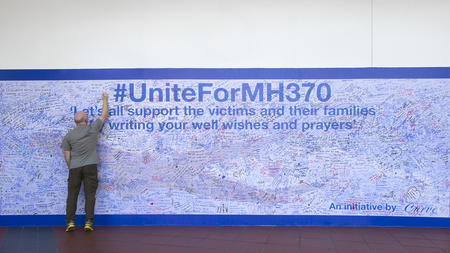 Kuala Lumpur, Malaysia 15 Mar 2014 - MH370 missing plane, Malaysians showing support by writing prayers on a wall at a shopping complex