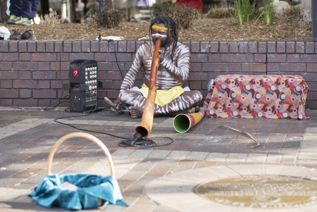SYDNEY, AUSTRALIA - Sept 12, 2015 - An Aborigine street performer, performing at Circular Quay.