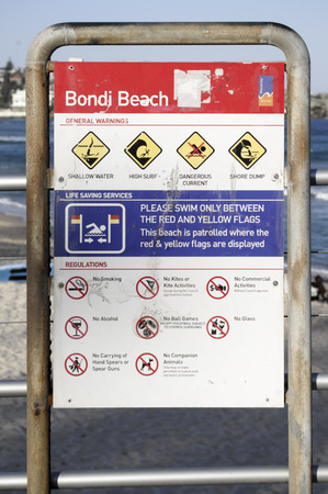 SYDNEY, AUSTRALIA - Sept 14, 2015 - Regulations and warning sign at Bondi Beach.