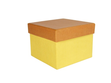 Yellow closed box with a brown cap. Isolated Stock Photo - 8708362
