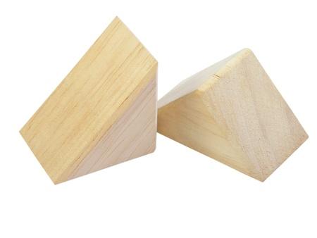 Triangular wooden blocks on a white background