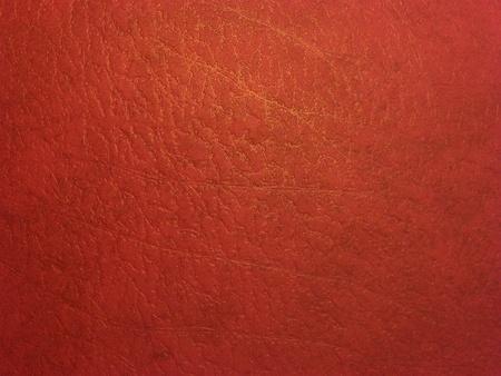 Dark red skin texture with a golden pattern