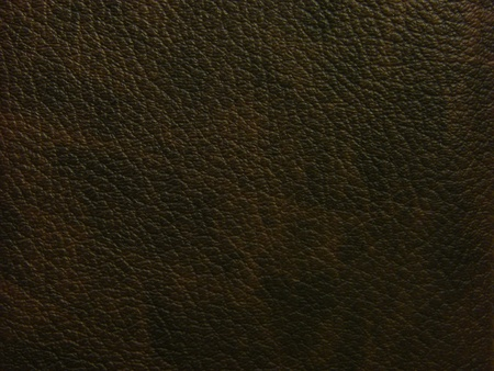 A rough textured dark brown leather background