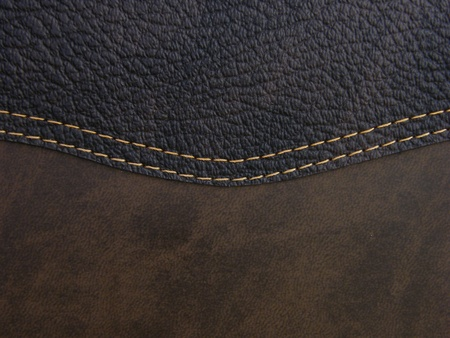 Rough textured dark brown leather with decorative stitching
