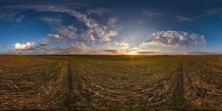 full seamless spherical panorama 360 degrees angle view among fields in evening sunset with awesome blue pink red clouds in equirectangular projection, ready for VR AR virtual reality