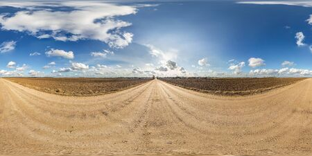 full seamless spherical panorama 360 degrees angle view on gravel road among fields in spring day with awesome clouds in equirectangular projection, ready for VR AR virtual reality content Banco de Imagens