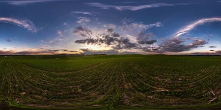 full seamless spherical hdri panorama 360 degrees angle view on among fields in spring evening before sunset with awesome clouds in equirectangular projection, ready for VR AR virtual reality content