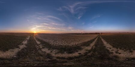 full seamless spherical hdri panorama 360 degrees angle view among fields in evening sunset with awesome blue pink red clouds in equirectangular projection, ready for VR AR virtual reality