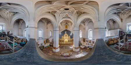 MUROVANKA, BELARUS - MARCH, 2020: Full spherical seamless hdri panorama 360 angle degrees view inside interior of old defense orthodox church with icons near altar in equirectangular projection