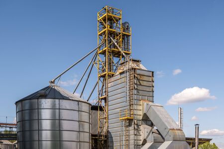 agro-processing and manufacturing plant for processing and silver silos for drying cleaning and storage of agricultural products, flour, cereals and grain. Granary elevator.  Banco de Imagens