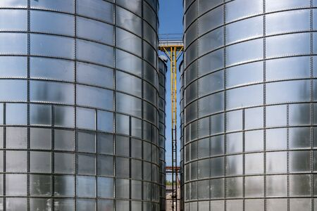 agro-processing and manufacturing plant for processing and silver silos for drying cleaning and storage of agricultural products, flour, cereals and grain. Granary elevator. 免版税图像 - 148103035