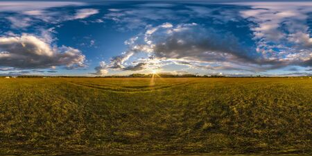 full seamless spherical hdri panorama 360 degrees angle view among fields in summer evening sunset with beautiful clouds in equirectangular projection, ready for VR AR virtual reality