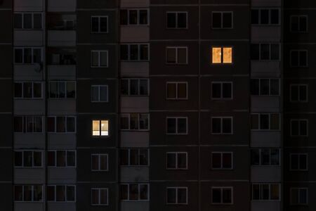 Flat night panorama of light in windows of multistory buildings. life in big city. concept for a couple in love on isolation