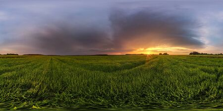 full spherical hdr panorama 360 degrees angle view among fields in summer evening sunset with beautiful clouds before storm in equirectangular projection, ready for VR AR virtual reality