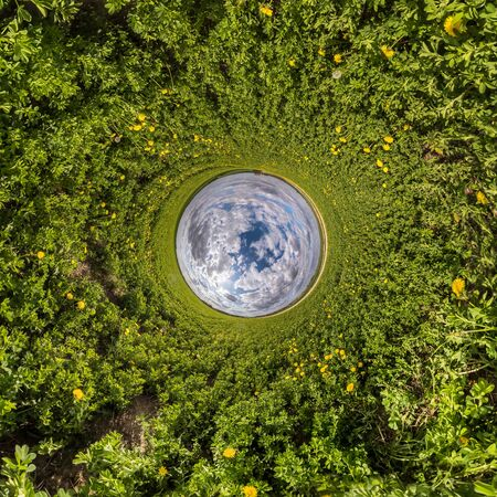 Inversion of little planet transformation of spherical panorama 360 degrees. Spherical abstract aerial view in field with awesome beautiful clouds. Curvature of space.