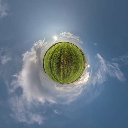 green little planet transformation of spherical panorama 360 degrees. Spherical abstract aerial view in field with awesome beautiful clouds. Curvature of space.
