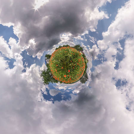 Little planet transformation of spherical panorama 360 degrees. Spherical abstract aerial view in poppy field with awesome beautiful clouds. Curvature of space.