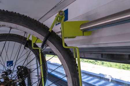 bike carrier on a train. Transport device for bicycles in the wagon.
