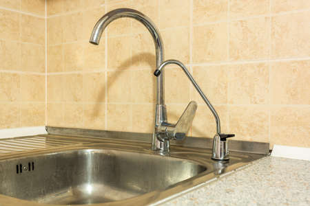 water tap sink with faucet in expensive loft bathroom or kitchen.