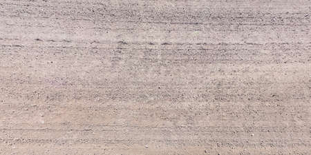 view from above on surface of gravel road with car tire tracks Banco de Imagens