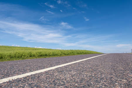 Asphalt highway empty road and clear blue sky with panoramic landscape Stok Fotoğraf