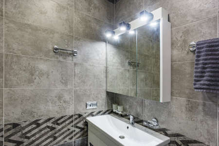 water tap sink with faucet in expensive loft bathroom. detail of a corner shower cabin with wall mount shower attachment