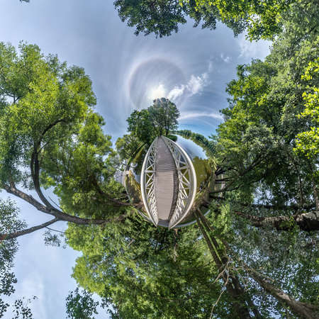 tiny planet transformation of spherical panorama 360 degrees. Spherical abstract aerial view in forest near lake. Curvature of space.
