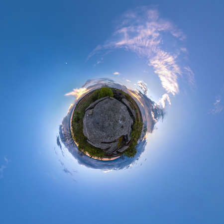 tiny planet transformation of spherical panorama 360 degrees. Spherical abstract aerial view on road with blue sky and awesome beautiful clouds. Curvature of space. Stock Photo
